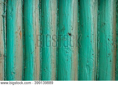 Close-up Of The Wooden Wall Painted With Turquoise Blue Colour. Old Paintwork On The Wall. An Old Co