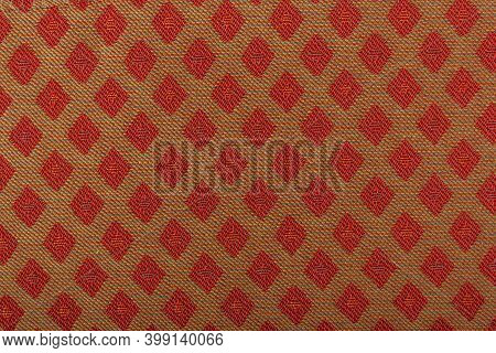 Yellow Fabric With Red Lozenges As The Background Texture. Close-up Long And Wide Texture Of Natural