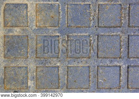 Rusty Sewer Manhole Cover. Geometric Pattern On The Cover Of The Sewer Manhole. Rusty Sewer Manhole