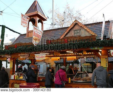 Hannover,germany-december 1: Customers Enjoying Traditional German Food At  Christmas Market Weihnac