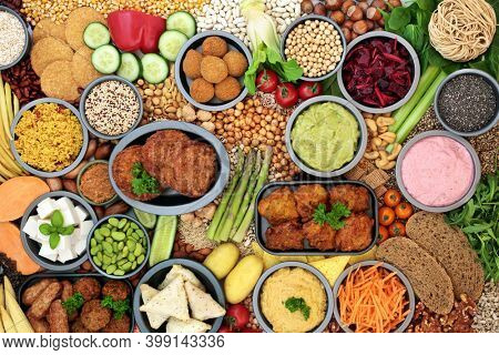 Vegan and  vegetarian food for a healthy lifestyle with plant based foods high in antioxidants, protein, minerals, fibre, carotenoids, anthocyanins, vitamins, omega 3 and smart carbs. Top view.