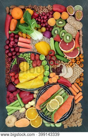 Pescatarian healthy diet food high in antioxidants, fibre, anthocyanins, carotenoids, minerals, vitamins, protein and omega 3. Superfoods of fish, fruit, vegetables, legumes, seeds, cereals and nuts.