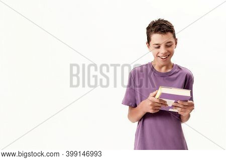 Portrait Of Teenaged Disabled Boy With Cerebral Palsy Smiling And Holding A Book, Posing Isolated Ov