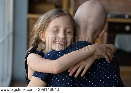 Close Up Smiling Little Daughter Hugging Sick Hairless Mother