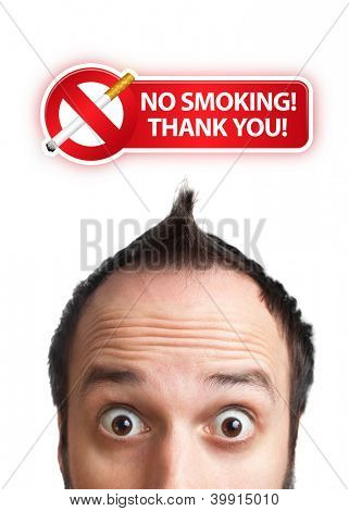 Young man with NO SMOKING sign over his head , isolated on white background