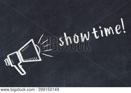 Chalk Drawing Of Loudspeaker And Handwritten Inscription Showtime On Black Desk