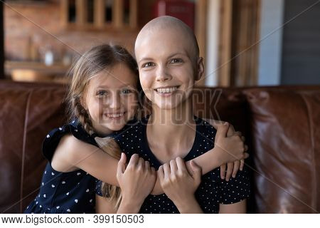 Head Shot Portrait Smiling Hairless Mother And Daughter Hugging