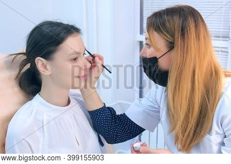 Cosmetologist Is Painting Pencil Shape Of Eyebrows Woman Before Tint Procedure In Beauty Clinic. Pro