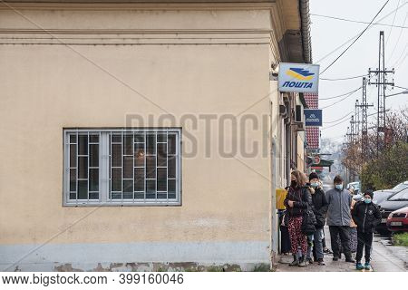 Subotica, Serbia - November 20, 2020:  Crowd Of People In A Waiting Queue In Front Of A Post Office