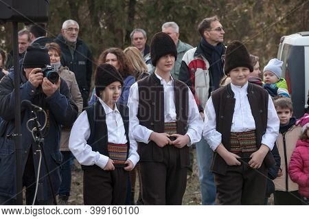 Kacarevo, Serbia - February 9, 2019: Three Young Boys, Children, Standing Smiling Wearing A Traditio