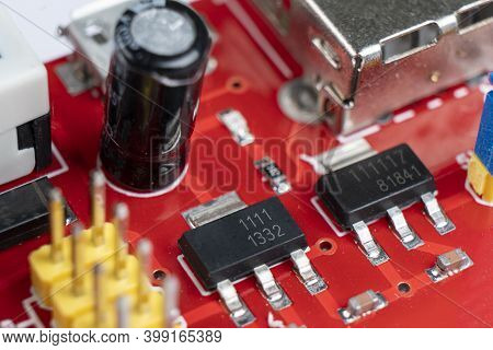 Macro Shot Of Circuit Board With Resistors Microchips And Electronic Components. Integrated Communic