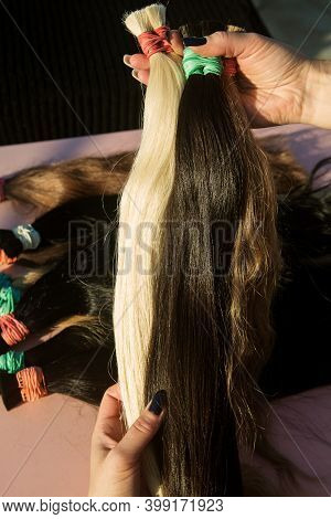 Strands Of Natural Womens Hair For Encapsulation And Extension In A Beauty Salon. High Quality Photo