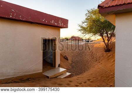 Abandoned Residential Buildings Buried In Sand In Al Madam Ghost Village In Sharjah, United Arab Emi