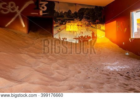 Demolished House Interior With Colorful Wallpaper Buried In Sand In Al Madam Ghost Town In United Ar