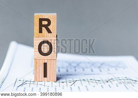 Letter Of The Alphabet Of Roi On A Grey Background. Roi - Return On Investment