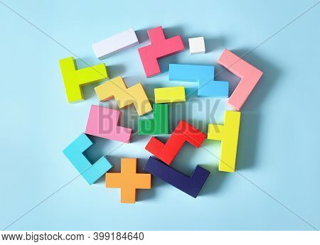 Concept Of Creative, Logical Thinking. Different Colorful Shapes Wooden Blocks On Light Background.