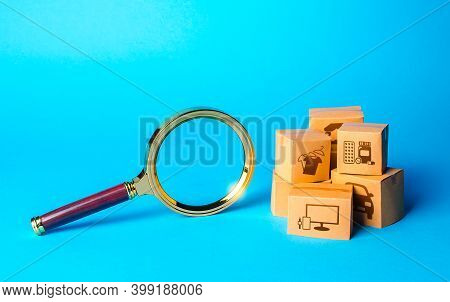 Boxes With Goods And Magnifying Glass. Search For Great Deals And Sales. Holiday Sale. Monitoring An