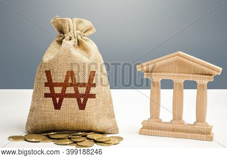 South Korean Won Money Bag And Bank / Government Building. Budgeting, National Financial System. Len