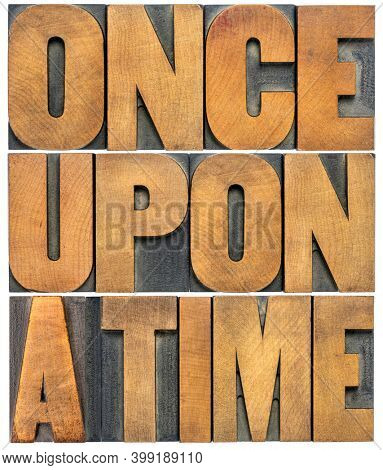 once upon a time opening phrase - storytelling concept - isolated word abstract in vintage letterpress wood type