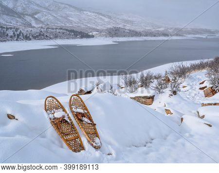 winter scenery of Horsetooh Reservoir in northern Colorado with classic showshoes