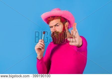 Gay. Homosexuality. Gay With Lollipop. Portrait Of Gay Cowboy. Man Wearing Cowboy Hat. American Band