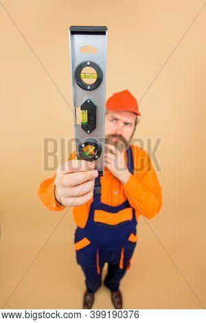 Advertising. Repairman. Bearded Builder. Bearded Man With Level. Repair Spirit Level. Repairman. Wor