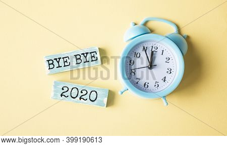 Bye Bye 2020, Word Cube With Background And Alarm Clock