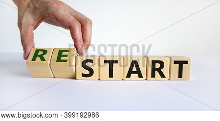 Restart Symbol. Concept Word 'restart' On Cubes On A Beautiful White Table. Male Hand. White Backgro