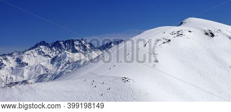 Snowboarders And Skiers On Snowy Off-piste Slope At Sun Day. Caucasus Mountains At Winter, Georgia,