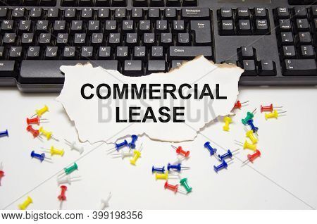 The Text Commercial Lease Is Written On A White Sheet Of Paper That Lies On A Computer Keyboard And