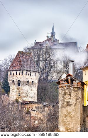 Defence Wall And The Tinkers Tower Of Sighisoara Citadel In Transylvania, Romania