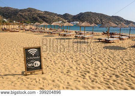 Ios, Greece - September 20, 2020: Free Wi-fi Information Board On Mylopotas Beach, A Popular Tourist