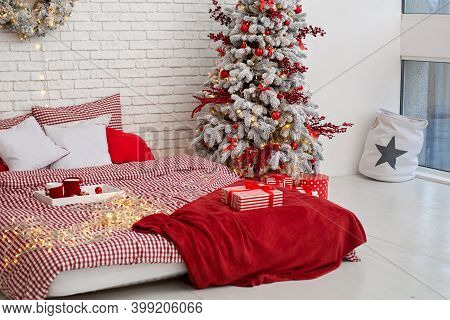 Bedroom Interior With Christmas Pillows, Bed Linen And Red Plaid. Cozy Decorated Bedroom For Christm