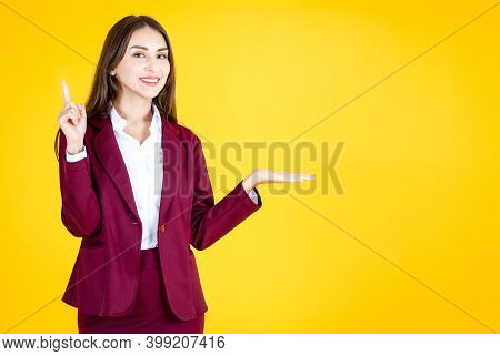 Women Present Products On A Yellow Background.copy Space