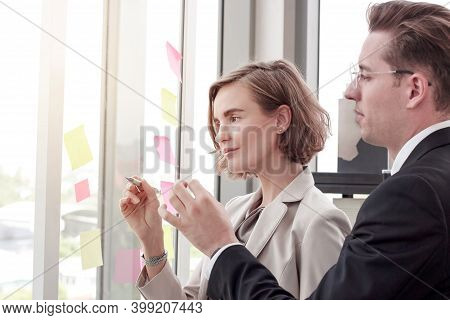 Business Men And Women Are Discussing Work