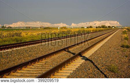 Railroad Heading Across The Nebraska Plain Toward Scotts Bluff National Monument In Early Morning Li