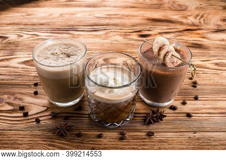 Three Glass Mugs With Various Coffee Cocktails, Set Of Warm Drinks On A Wooden Table, Cocoa, Hot Cho