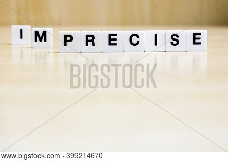 A Row Of Small White Plastic Tiles, Containing The Letters Forming The Word Precise, To Represents T