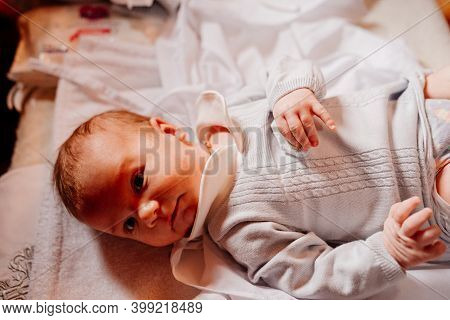 An Infant Is Lying On A Dressing Table In The Church. The Ordinance Of Baptism.