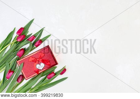 Red Tulips And A Gift Box.
