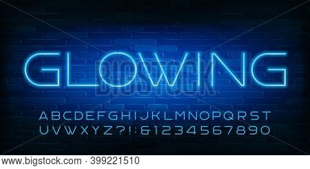 Glowing Alphabet Font. Blue Neon Light Letters, Numbers And Symbols. Brick Wall Background. Stock Ve