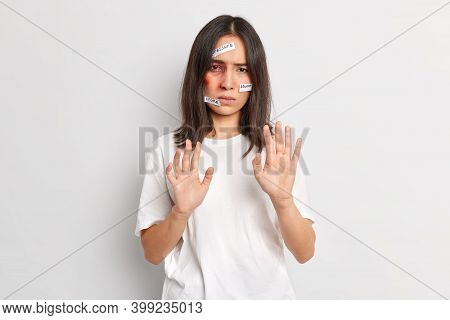 Dont Touch Me. Displeased Abused Asian Woman Victim Stretches Out Hands Asks Stop Hurting Her Has Bi