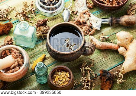 Herbal Tea On Old Wooden Table