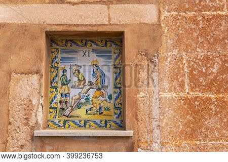 Campos, Spain; December 2020: Ceramic Mural With A Christian Religious Theme, The Crucifixion Of Chr