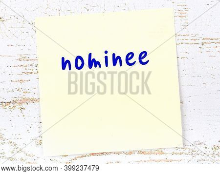 Concept Of Reminder About Nominee. Yellow Sticky Sheet Of Paper On Wooden Wall With Inscription