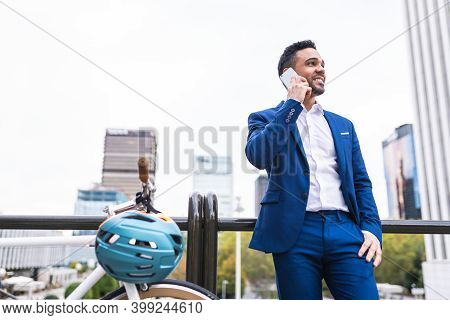 Latino Businessman Having Phone Call Outdoors.