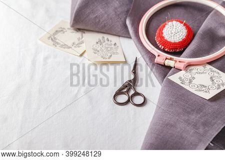 Embroidery Set. White Linen Fabric, Embroidery Patterns, Embroidery Hoop And Needls. Copy Space, Top