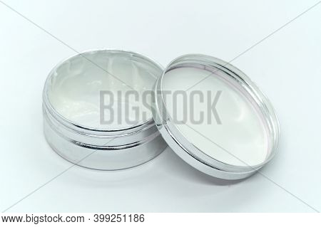 White Cream In Open Round Aluminum Metal Tin On White Background. Natural Cosmetic Product. Face And