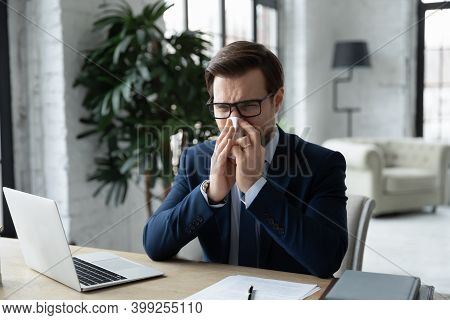 Unhealthy Young Businessman Blowing Running Nose, Holding Paper Napkin