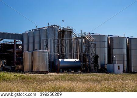 Vertical Winemaking Tanks. Modern Technological Industrial Equipment.